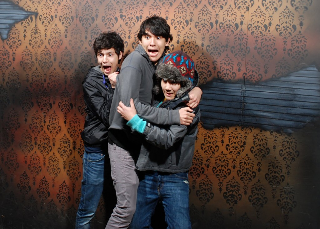 Nightmares Fear Factory guests clutching each other for comfort in the maze