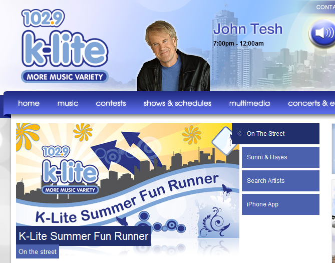 Screengrab of the K-Lite website, featuring John Tesh in the banner